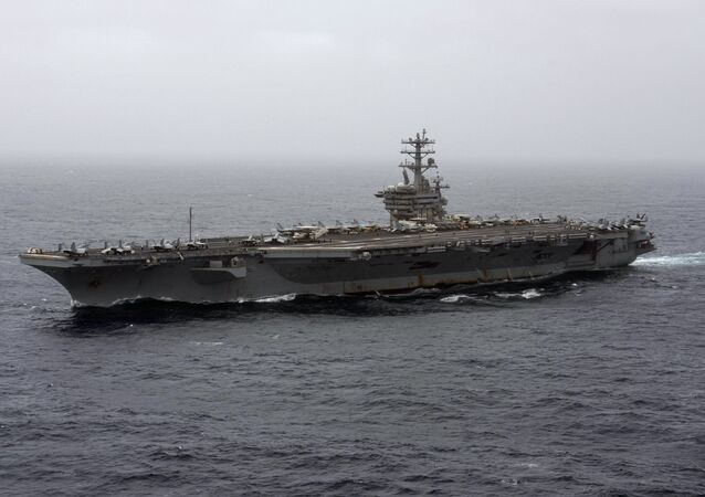 In this Sept. 7, 2020, file photo released by the U.S. Navy, the aircraft carrier USS Nimitz transits the Arabian Sea.