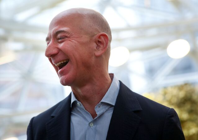 Amazon founder and CEO Jeff Bezos laughs as he talks to the media while touring the new Amazon Spheres during the grand opening at Amazon's Seattle headquarters in Seattle, Washington