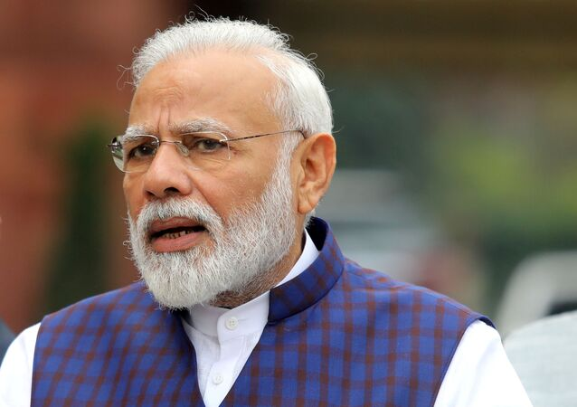 India's Prime Minister Narendra Modi speaks to the media inside the parliament premises on the first day of the winter session in New Delhi, India
