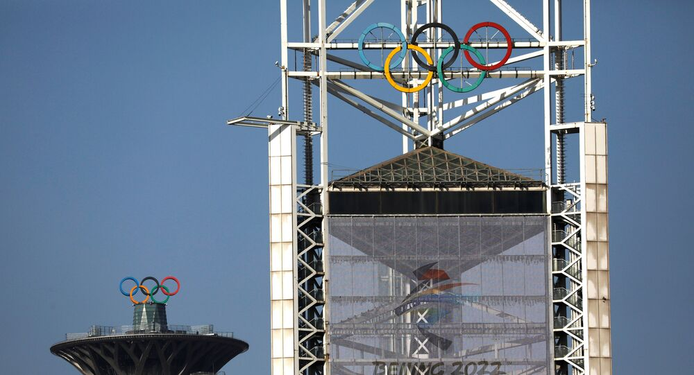 Olympic rings and a sign of 2022 Winter Olympic Games, are seen at the Beijing Olympic Green in Beijing, China, January 29, 2021. Picture taken January 29, 2021.