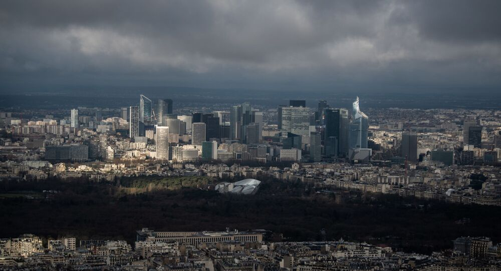 A picture taken on February 1, 2021 in Paris, shows the business district of La Defense on a cloudy day. (Photo by Martin BUREAU / AFP)