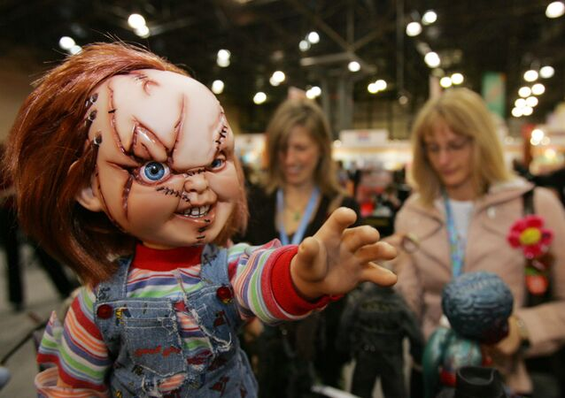 Visitors look at the Chucky doll from the Bride of Chucky movie, at the Sideshow Collectibles booth during the American International Toy Fair, Sunday, Feb. 12, 2006 in New York.