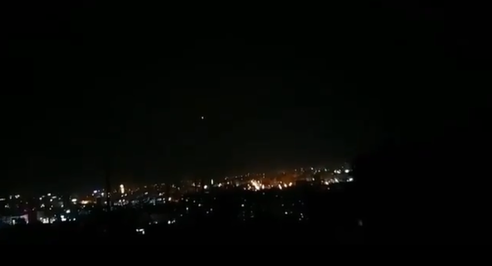 A screenshot from the video of the alleged anti-air missile exploding in the night sky in Syria