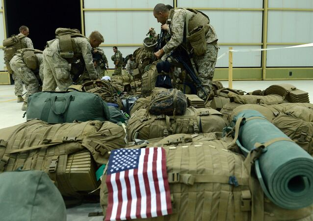 In this file photo US Marines arrange their equipment as US troops arrive in Kandahar after their withdrawl from the Camp Bastion-Leatherneck complex in Helmand province on October 26, 2014.