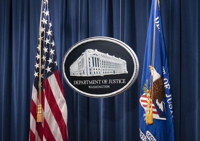 A sign for the Department of Justice is seen ahead of a news conference with Michael Sherwin, acting US attorney for the District of Columbia, and Steven D'Antuono, head of the Federal Bureau of Investigation (FBI) Washington field office, at the US Department of Justice in Washington, DC, on January 12, 2021.