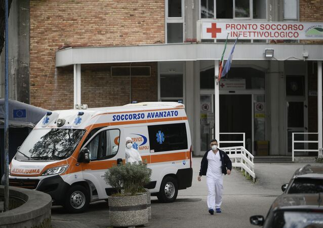 An ambulance is parked outside the entrance to the infectious diseases emergency unit at the Cotugno hospital in Naples on November 12, 2020 amid a surge of COVID-19 cases in Naples overwhelming hospitals.