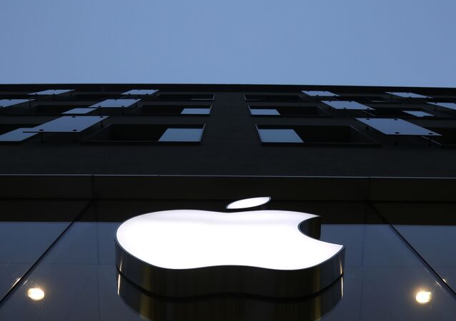 The logo of Apple is illuminated at a store in the city center in Munich, Germany, Wednesday, Dec. 16, 2020.