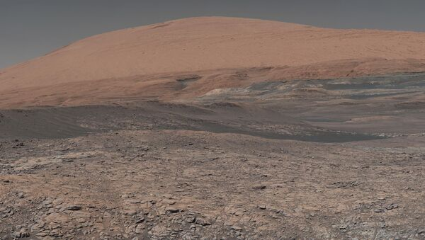 This image provided by NASA, assembled from a series of January 2018 photos made by the Mars Curiosity rover, shows an uphill view of Mount Sharp, which Curiosity has been climbing. - Sputnik International