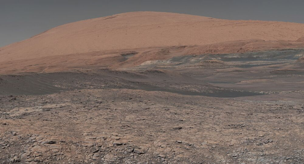 This image provided by NASA, assembled from a series of January 2018 photos made by the Mars Curiosity rover, shows an uphill view of Mount Sharp, which Curiosity has been climbing.