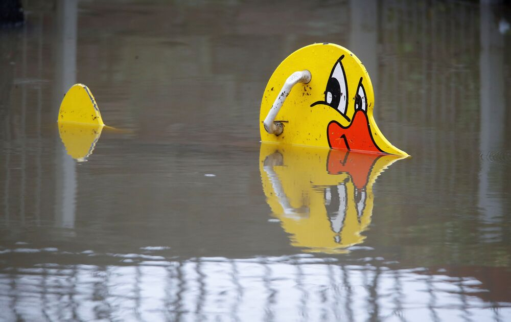 A floating rubber duck is seen at a flooded children's playground in Vallendar near Koblenz, Germany, 3 February 2021.