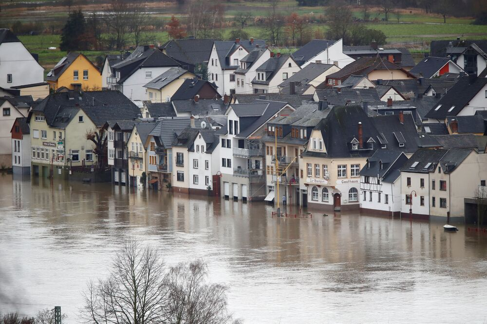 Houses on Niederwerth Island are seen flooded by Europe's most frequented waterway, the Rhine River in Vallendar near Koblenz, Germany, 3 February 2021.