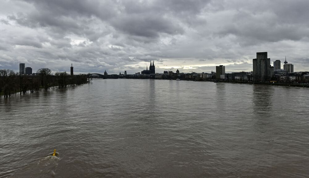 Dark clouds are seen above the Rhine River near the Cologne Cathedral, Wednesday, 3 February 2021.