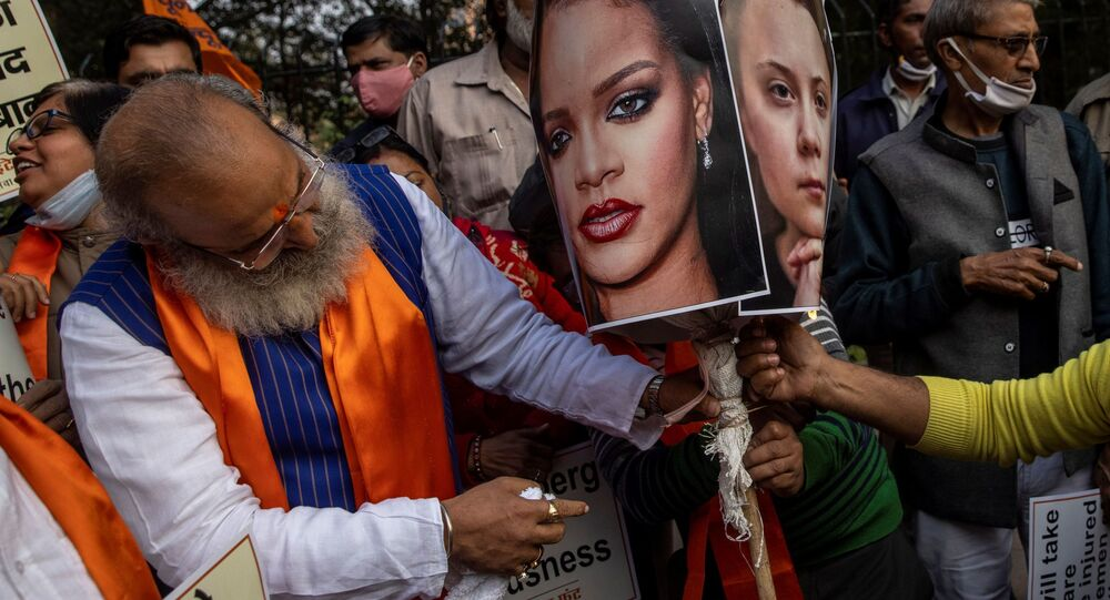 Activists from United Hindu Front burn an effigy depicting U.S. singer Rihanna and climate change activist Greta Thunberg to protest against the celebrities for commenting in support of protesting farmers