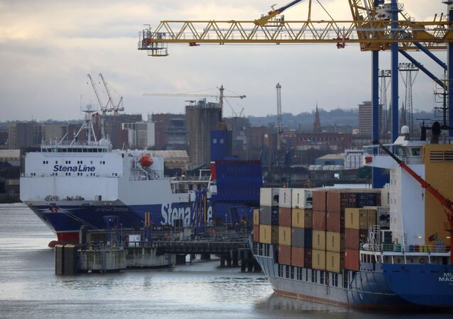 A Stena Line Irish Sea ferry is berthed next to a container ship at the Port of Belfast, Northern Ireland January 2, 2021. REUTERS/Phil Noble/File Photo