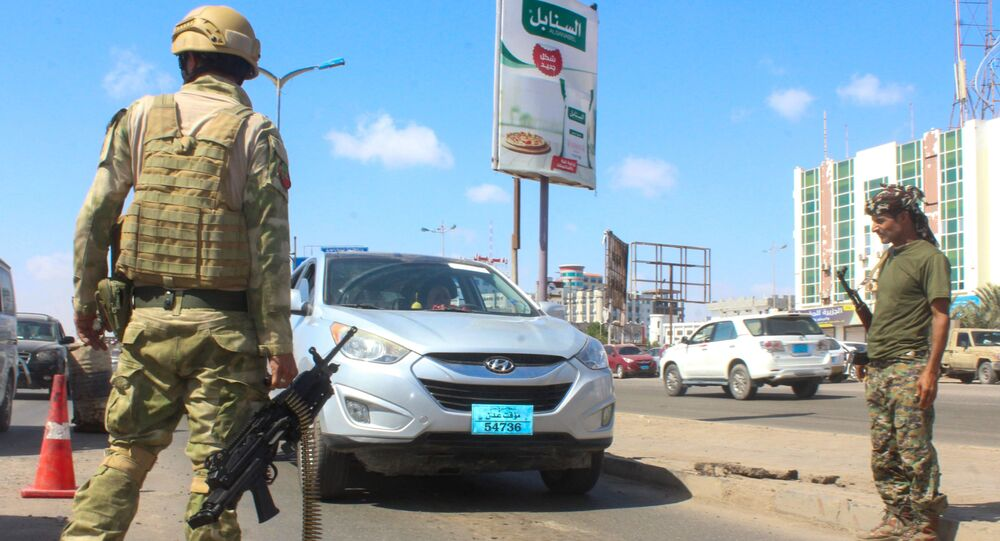 Fighters with the Saudi-backed coalition man a checkpoint in Dar Sad, north of Yemen's southern city of Aden on December 31, 2020.
