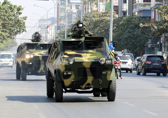 Myanmar Army armored vehicles drive in a street after the military seized power in a coup in Mandalay, Myanmar February 3, 2021.