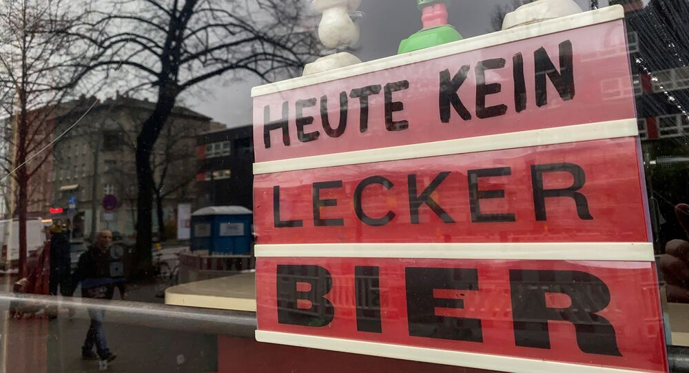 A sign which reads No tasty beer today is on display in the window of a closed bar in Berlin's Kreuzberg district on February 4, 2021 amid the ongoing coronavirus COVID-19 pandemic.