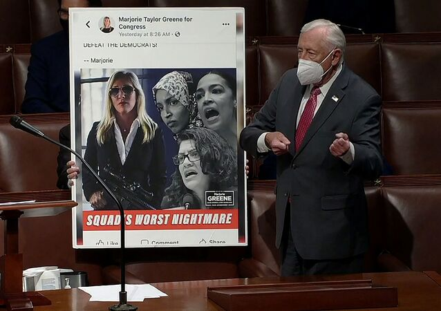 U.S. House Majority Leader Steny Hoyer (D-MD) mimics holding a gun next to an enlarged Tweet as he speaks during debate ahead of a House of Representatives vote on a Democratic-backed resolution that would punish Republican congresswoman Marjorie Taylor Greene, in this frame grab from video shot inside the House Chamber of the Capitol in Washington, U.S., February 4, 2021.