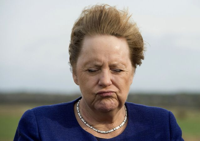 German Chancellor Angela Merkel closes her eyes as the wind blows through her hair during a visit on the small island Ummanz at the Baltic Sea, Germany, Friday, Oct. 25, 2019. (Stefan Sauer/DPA via AP)