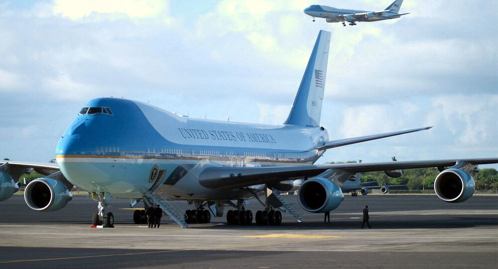 Air Force One lands at Hickam Air Force (AFB) with US President George W. Bush on board for his first visit to Hawaii while holding office. On the ground, the second Boeing VC-25A.