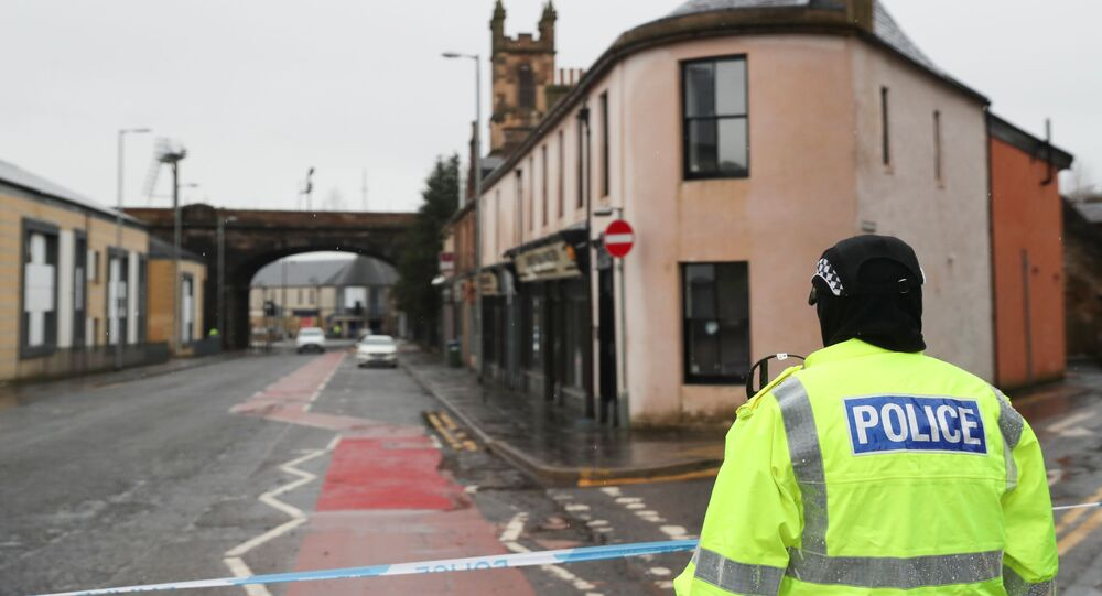 A police officer stands guard on Portland Street, following three major incidents reported in Kilmarnock, Scotland, Britain, February 5, 2021.