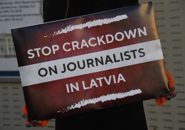 Journalist and member of the Russian Civic Chamber Maria Butina holds a placard during a single-person picket against the persecution of Baltnews and Sputnik journalists in Latvia, in front of Latvian embassy in Moscow, Russia. On December 2020, several Russian-speaking Latvian stringers who work with Sputnik and Baltnews, among other outlets, had their apartments searched and were prohibited from leaving the country on suspicion of breaking the EU sanctions. Baltnews and Sputnik Latvia are connected to Rossiya Segodnya information agency.