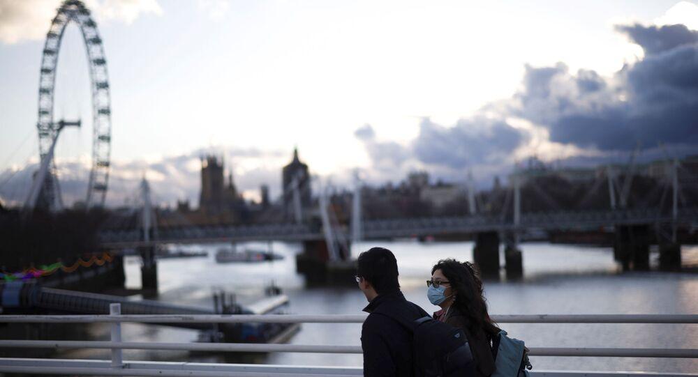 People walk over Waterloo Bridge, as the coronavirus disease (COVID-19) rages through London, UK, 5 February 2021.