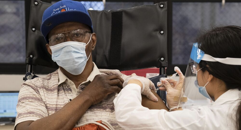 In this Jan. 15, 2021, file photo, a nursing home resident receives the COVID-19 vaccine by a CVS Pharmacist at Harlem Center for Nursing and Rehabilitation, a nursing home facility in Harlem neighborhood of New York.