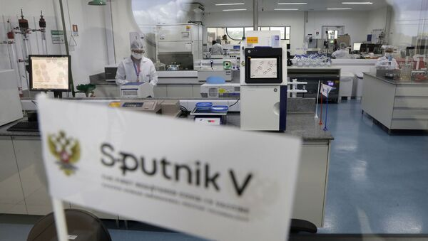 Laboratory workers work in the pilot production phase of Russia's Sputnik V Coronavirus vaccine for COVID-19 at the pharmaceutical company Uniao Quimica in Brasilia, Brazil, Monday, Jan. 25, 2021. - Sputnik International
