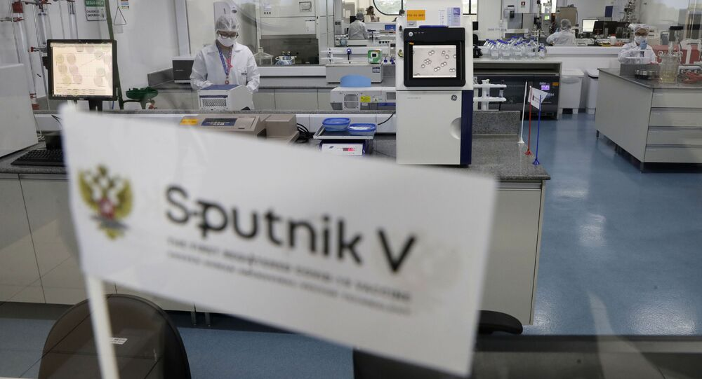Laboratory workers work in the pilot production phase of Russia's Sputnik V Coronavirus vaccine for COVID-19 at the pharmaceutical company Uniao Quimica in Brasilia, Brazil, Monday, Jan. 25, 2021.