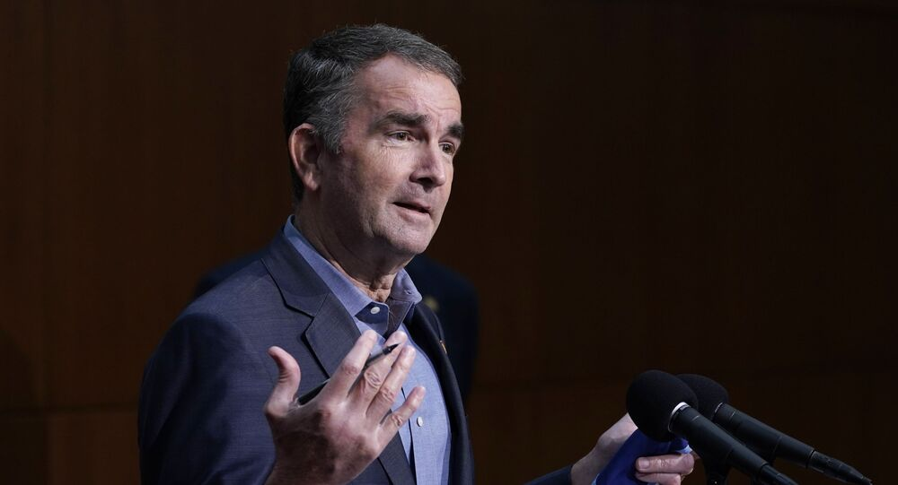 Virginia Gov. Ralph Northam gestures during a COVID-19 briefing at the Capitol in Richmond, Va, Wednesday Nov 18, 2020.