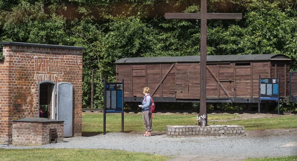 In this file photo taken on July 21, 2020 a woman is seen next to a gas chamber at the museum of the former Nazi Death Camp Stutthof, in Sztutowo, July 21, 2020.