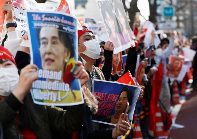 Protesters from Myanmar residing in Japan hold signs with photos of leader Aung San Suu Kyi at a rally against Myanmar's military after it seized power from a democratically elected civilian government and arrested Suu Kyi, outside Foreign Ministry in Tokyo, Japan February 3, 2021.