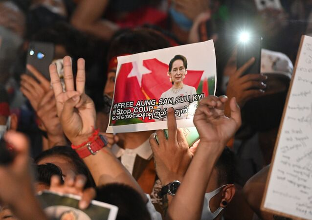 A protester holds an image of the detained Myanmar civilian leader Aung San Suu Kyi during a demonstration condemning the military coup outside the Myanmar embassy in Bangkok on February 4, 2021, days after Myanmar's security forces detained Suu Kyi and the country's president.