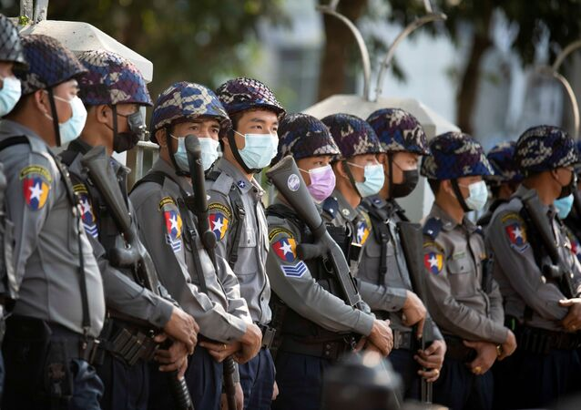 Police officers wait for protests against coup in Yangon, Myanmar 4 February 2021. REUTERS/Stringer