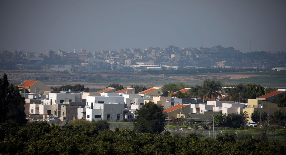 A general view shows an Israeli village in the foreground and part of the Gaza Strip, as it is seen from the Israeli side of the Israel- Gaza border February 6, 2021. REUTERS/Amir Cohen