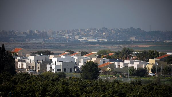 A general view shows an Israeli village in the foreground and part of the Gaza Strip, as it is seen from the Israeli side of the Israel- Gaza border February 6, 2021. REUTERS/Amir Cohen - Sputnik International