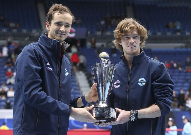 Russia's ATP Cup winners Daniil Medvedev, and Andrey Rublev, right, pose with their trophy after defeating Italy in the final in Melbourne, Australia, Sunday, Feb. 7, 2021.