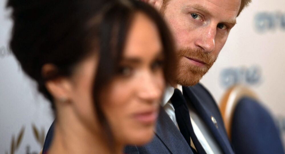 Britain's Prince Harry and Meghan Duchess of Sussex attend a roundtable discussion on gender equality at Windsor Castle in Windsor, England, Friday Oct. 25, 2019.