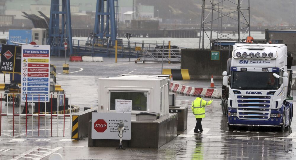 Trucks leaving Larne Port, in Belfast, Northern Ireland, Wednesday, Feb. 3, 2021