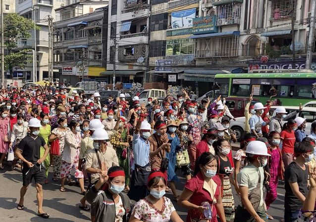 In this image from video, a crowd of protesters march in Yangon, Myanmar Saturday, Feb. 6, 2021