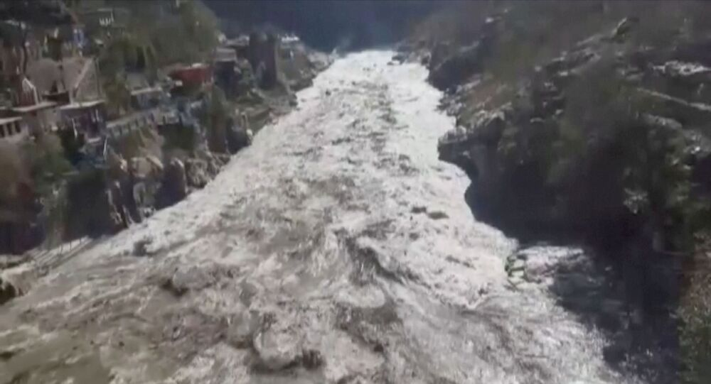 General view during a flood in Chamoli, Uttarakhand, India February 7, 2021 in this still image obtained from a video.