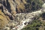 This frame grab from video provided by KK Productions shows a massive flood of water, mud and debris flowing at Chamoli District after a portion of Nanda Devi glacier broke off in Tapovan area of the northern state of Uttarakhand, India, Sunday, Feb.7, 2021.