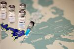 FILE PHOTO: Vials labelled COVID-19 Coronavirus-Vaccine and medical syringe are placed on the European Union map in this picture illustration taken December 2, 2020. REUTERS/Dado Ruvic/Illustration/File Photo