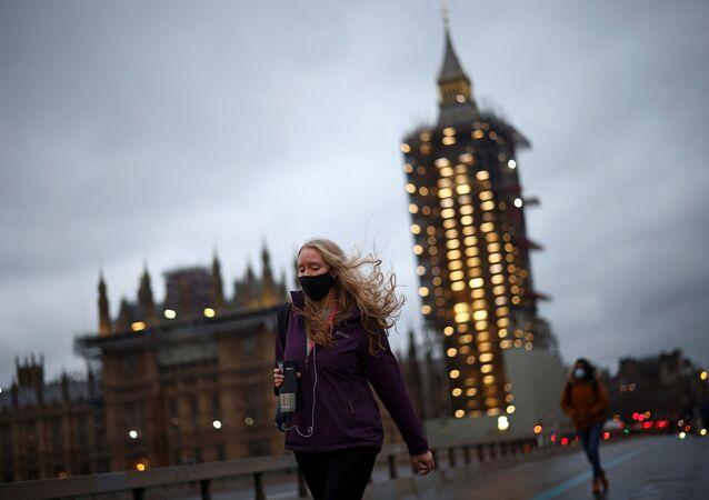 People walk on the Westminster Bridge, amid the coronavirus disease (COVID-19) outbreak  in London, Britain, January 20, 2021