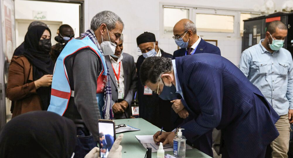 Fayez Sarraj, outgoing prime minister of the UN-recognised Libyan Government of National Accord (GNA), registers to vote during an election for the Tripoli Municipal Council, in Libya's capital on February 6, 2021.