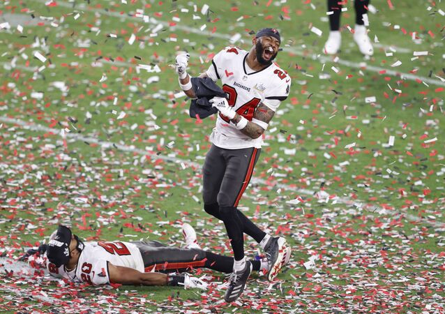 Feb 7, 2020; Tampa, FL, USA; Tampa Bay Buccaneers cornerback Carlton Davis (24) and defensive back Andrew Adams (26) celebrate after defeating the Kansas City Chiefs in Super Bowl LV at Raymond James Stadium.