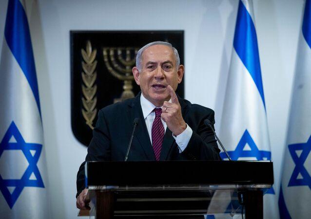 Israeli Prime Minister Benjamin Netanyahu delivers a speech at the Knesset (Israeli Parliament) in Jerusalem on December 22, 2020.
