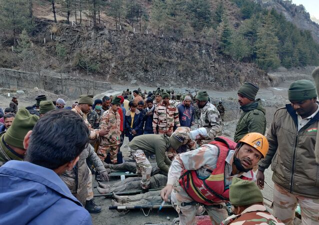 Members of Indo-Tibetan Border Police (ITBP) tend to people rescued after a Himalayan glacier broke and swept away a small hydroelectric dam, in Chormi village in Tapovan in the northern state of Uttarakhand, India, February 7, 2021.