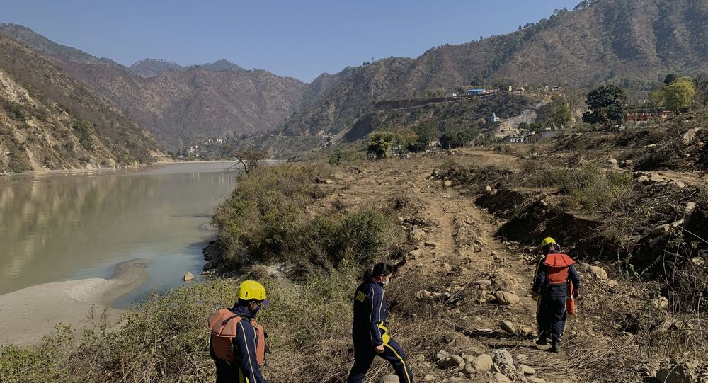Rescuers arrive to search for bodies in the downstream of Alaknanda River in Rudraprayag, northern state of Uttarakhand, India, Monday, Feb.8, 2021.